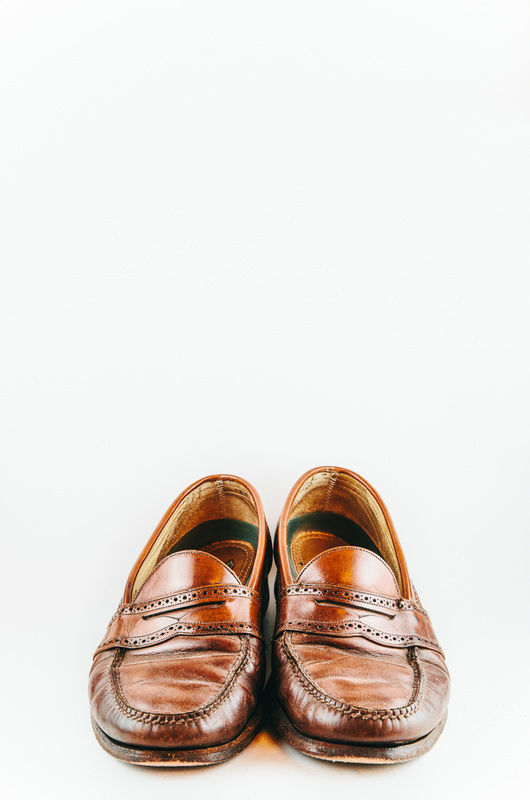 worn pair of men's loafer shoes