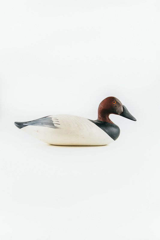 painted wooden carving of a duck