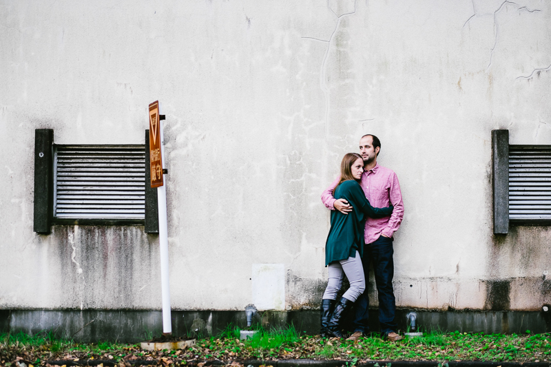 couple standing against wall in Mitaka, Japan