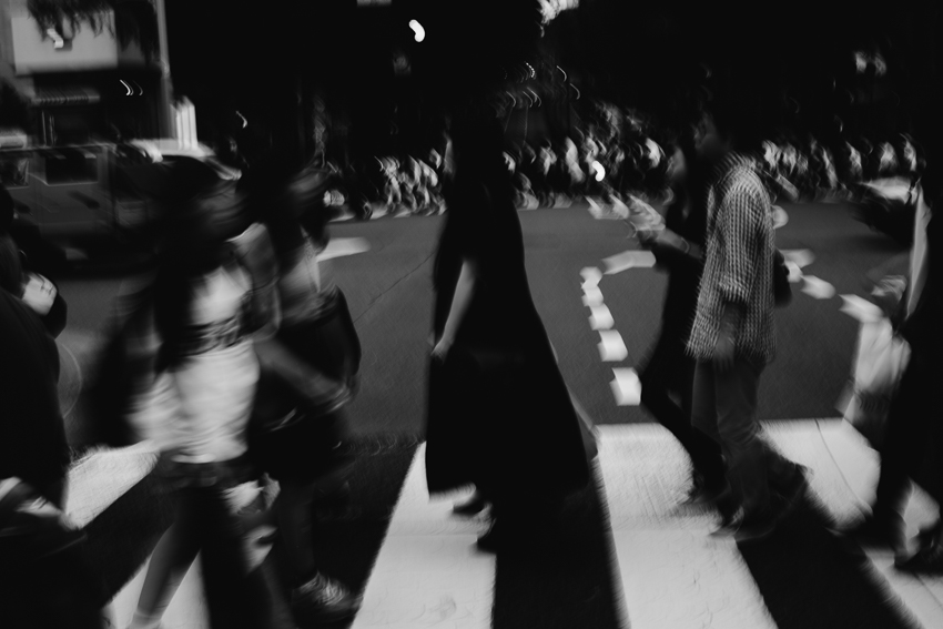 Blurry street photography of pedestrians crossing the street in Harajuku