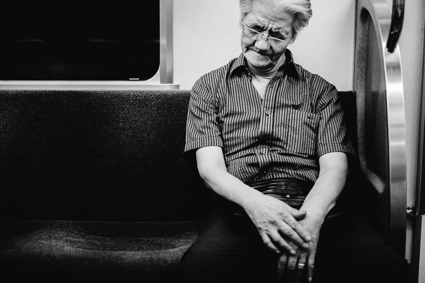 elderly gentleman sleeps on a train bound for Tokyo