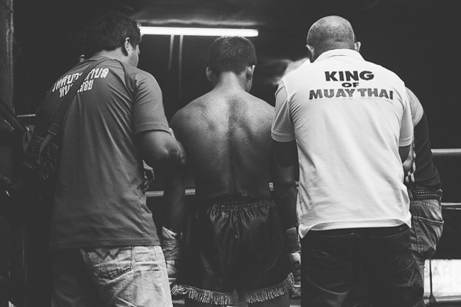 Muay Thai trainers prepare their fighter