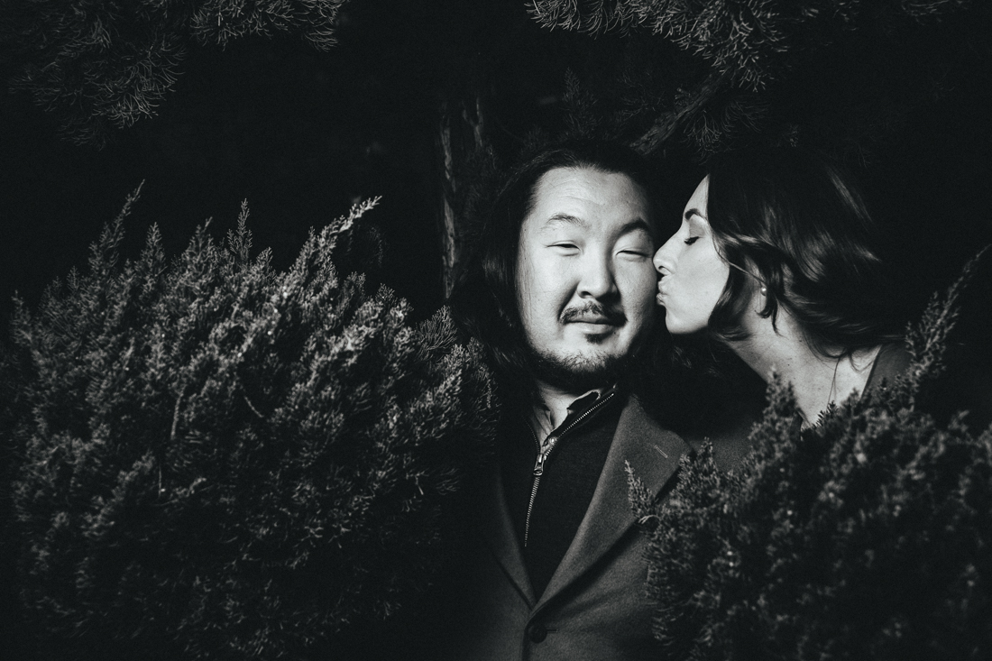 Tokyo pre-wedding portrait of beauty girl kissing fiance in the bushes