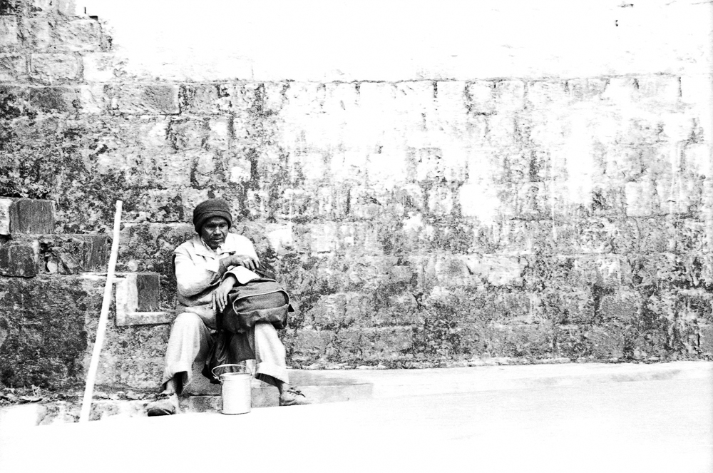 blind man sits and rest in India