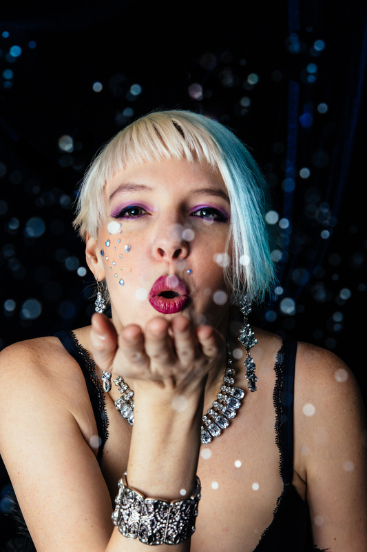 Nell Fox blowing glitter