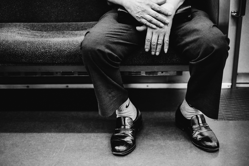Hands and shoes of a train passenger in Japan