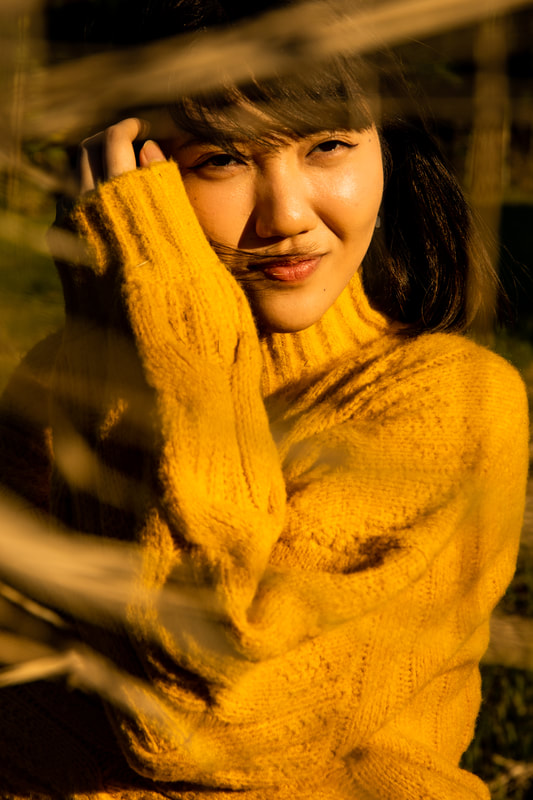 Aya in yellow sweater