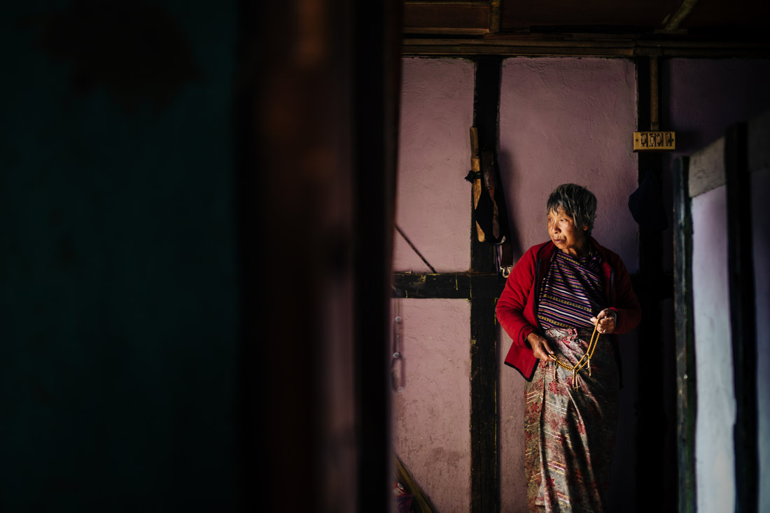 Bhutanese grandmother in home