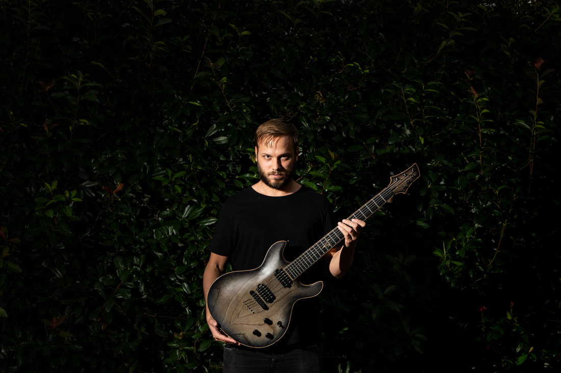 David Ahfeldt holding guitar