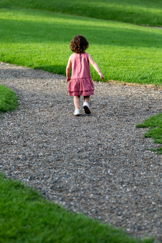 Toddler walks on path