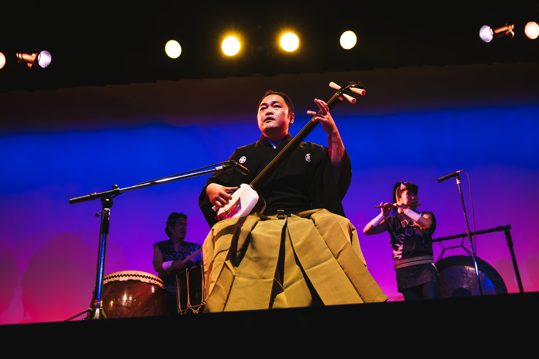 shamisen player on stage