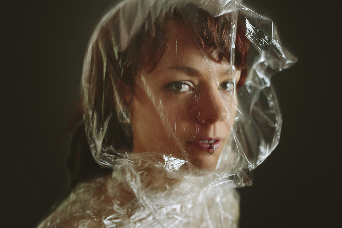 Maddy wrapped in plastic