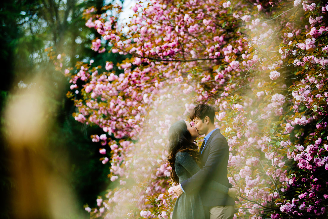 Couple kissing in flowers