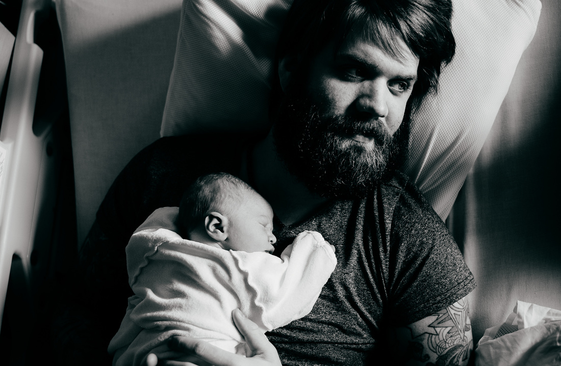 newborn son with father