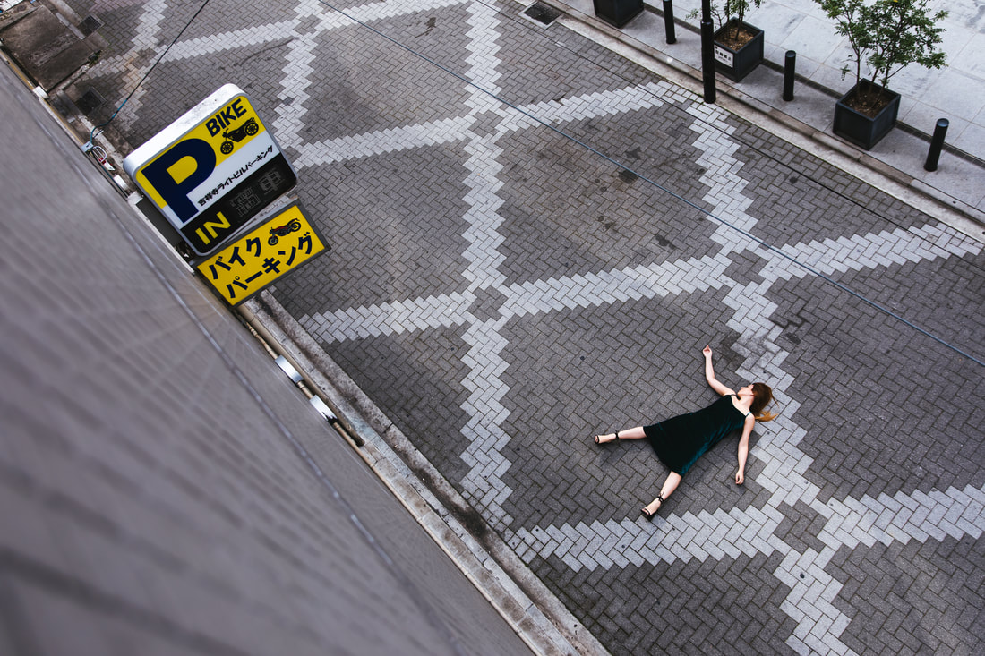Nuria laying down in street