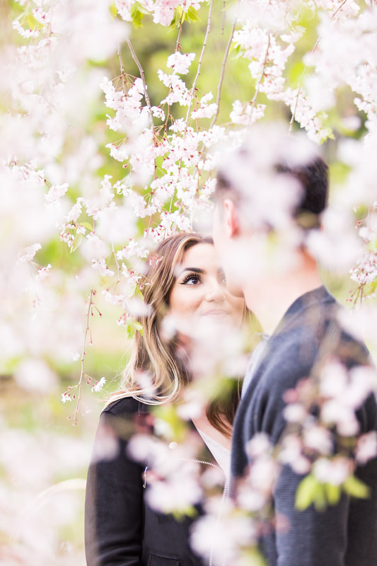 Lovers under blooming tree