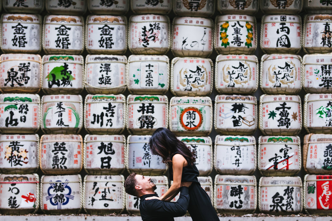 Happy couple with sake barrels